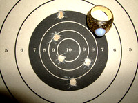 Taurus PT 1911, 230 grain .45 ACP, fired offhand, two handed hold, at 25 yards.